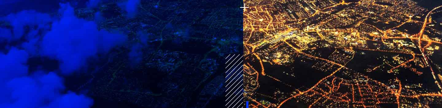 cityscape at night with a blue overlay on the left hand side