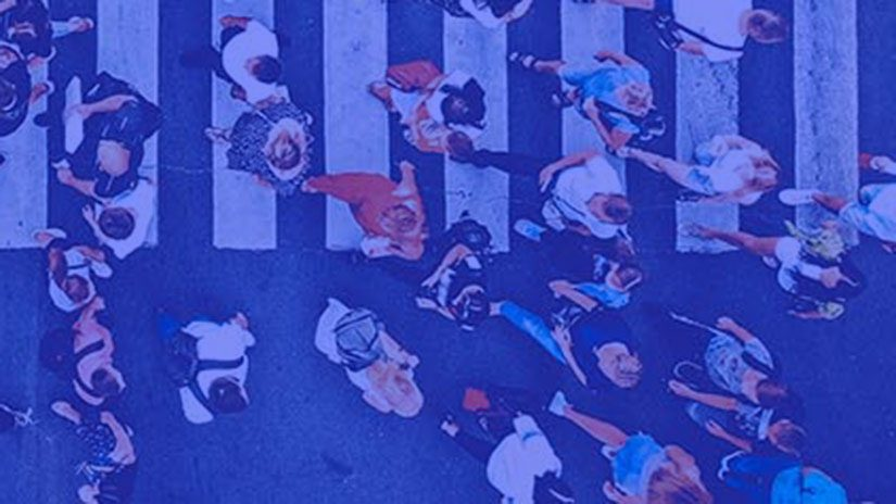 Top down view of people walking along a crossing