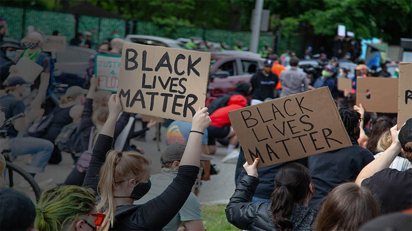 A crowd of people at a Black Lives Matter demonstration.