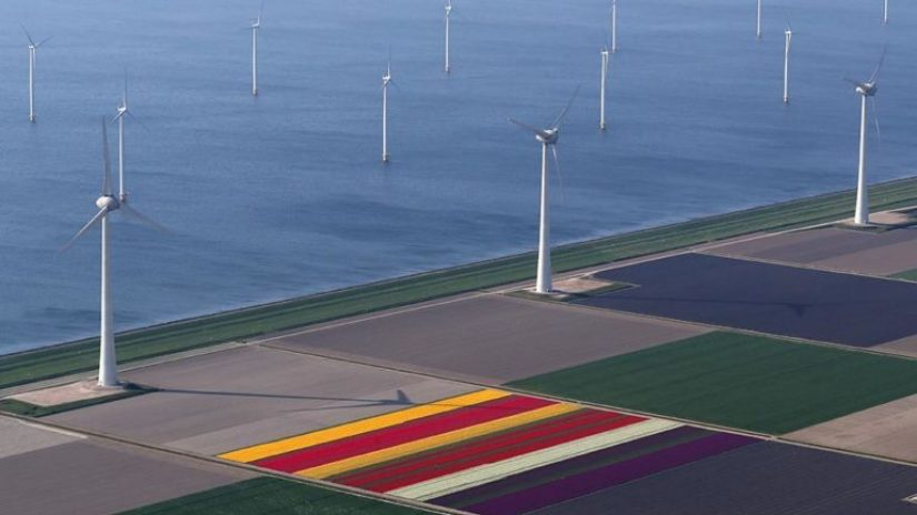 An aerial view of tulip fields and wind turbines on the coast near the city of Creil, Netherlands April 18, 2019.