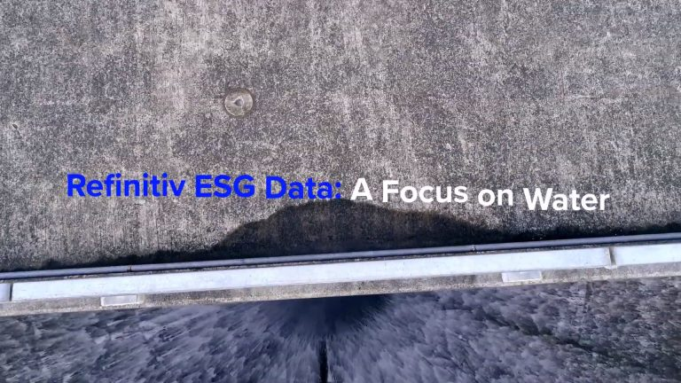Arial shot of water falling from a concrete dam with the text: Refinitiv ESG Data a focus on water.