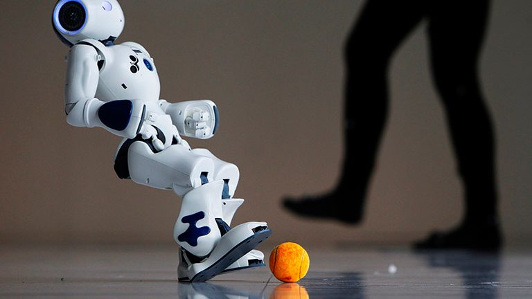 A robot from Android FC, a three-robot soccer team from the School of Infomatics at the University of Edinburgh, shows off its skills during a photocall for their upcoming show in the Edinburgh International Science Festival in Edinburgh, Scotland April 1, 2010. The robot soccer players are fully autonomous and have embedded processors that enable them to make sense of their surroundings and react to the movements of other players.