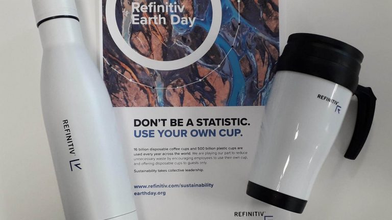 A Refinitiv social impact initiative where a Refinitiv Earth Day poster and two reusable mugs appear to encourage sustainable actions by their employees.