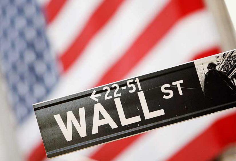 A Wall St. sign is seen outside the New York Stock Exchange,