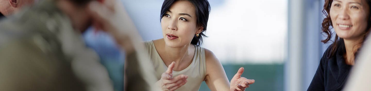 asian ethnicity woman in office meeting