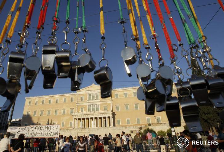 Whistles are seen in front of the parliament during a rally against the austerity economic measures and corruption at Syntagma (Constitution) square in Athens June 26, 2011. Greece's deputy prime minister warned that rebel lawmakers may yet block some reforms sought by international lenders, though parliament is expected to back an overall austerity package this week to avert national bankruptcy. REUTERS/John Kolesidis (GREECE - Tags: CIVIL UNREST POLITICS BUSINESS)