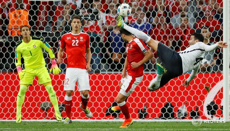 Football Soccer - Switzerland v France - EURO 2016 - Group A - Stade Pierre-Mauroy, Lille, France - 19/6/16France's Adil Rami fouls Switzerland's Admir Mehmedi resulting in a yellow cardREUTERS/Gonzalo FuentesLivepic TPX IMAGES OF THE DAY - RTX2H2X1