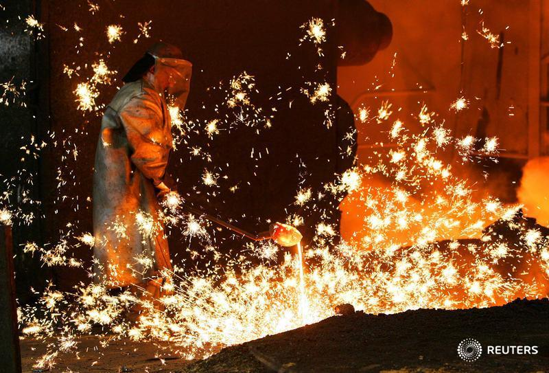 A worker at the Arcelor steel plant Cockerill Sambre works at a furnace in Ougree near the Belgian city of Liege January 30, 2006. The head of Mittal Steel said on Monday he did not plan to close Arcelor's steel plants in Europe, as he tried to win support for his 18.6 billion euro ($23 billion) bid for the European steel giant. REUTERS/Yves Herman - RTR19BKV