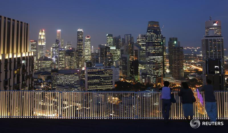 People look at the skyline of the central business district from the Skybridge of The Pinnacles at Duxton public housing estate in Singapore April 25, 2013. Banks in Singapore are urgently scrutinising their account holders as an imminent deadline on stricter tax evasion measures forces them to decide whether to send some of their wealthiest clients packing. The Southeast Asian city-state has grown into the world's fourth-biggest offshore financial centre but, with U.S. and European regulators on the hunt for tax cheats, the government is clamping down to forestall the kind of onslaught from foreign authorities that is now hitting Switzerland's banks. Before July 1, all financial institutions in Singapore must identify accounts they strongly suspect hold proceeds of fraudulent or wilful tax evasion and, where necessary, close them. After that, handling the proceeds of tax crimes will be a criminal offence under changes to the city-state's anti-money laundering law. Picture taken April 25, 2013. REUTERS/Edgar Su (SINGAPORE - Tags: CITYSCAPE BUSINESS) - RTXZBT7