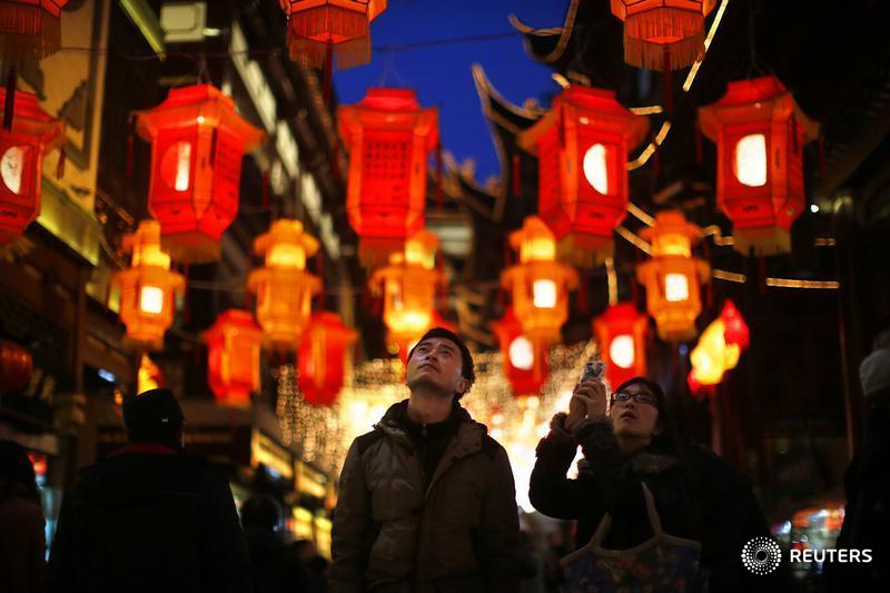 A couple look at Chinese New Year lanterns decorating Yuyuan Garden in downtown Shanghai