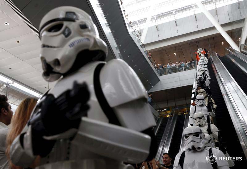 Stormtroopers take the escalator as they march around Singapore's Changi Airport November 12, 2015. Photography: Edgar Su