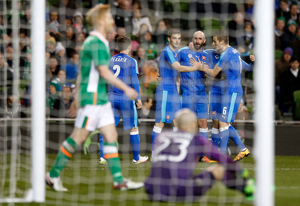 Slovakia's Robert Vittek celebrates with team mates after Republic of Ireland's Paul McShane scores an own goal. Photography: Reuters / Paul Childs