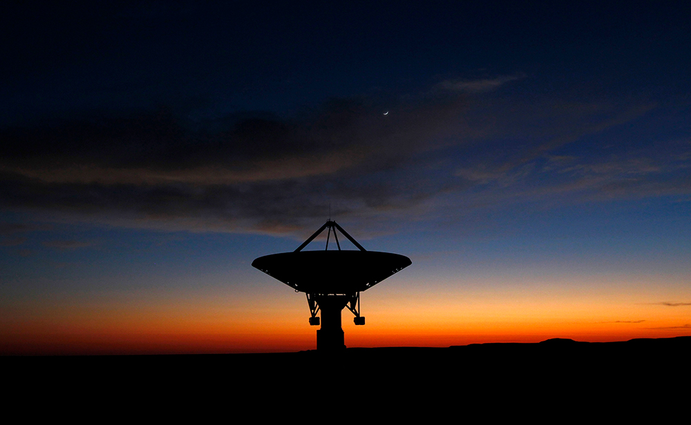 Dawn breaks over a radio telescope dish of the KAT-7 Array pointing skyward near Carnavon in the country's remote Northern Cape province. Photography: REUTERS/Mike Hutchings. Finding-market-liquidity-after-MiFID-II