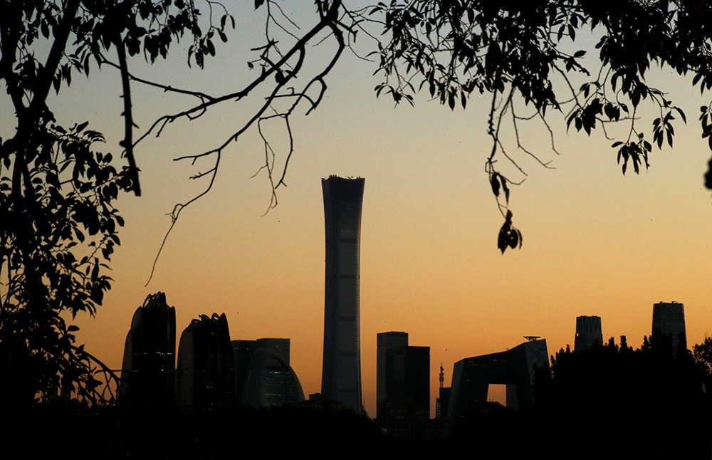 The cityscape of the Beijing Central Business District, or Beijing CBD, is silhouetted against the sky during sunset, China. New year, new opportunities in China