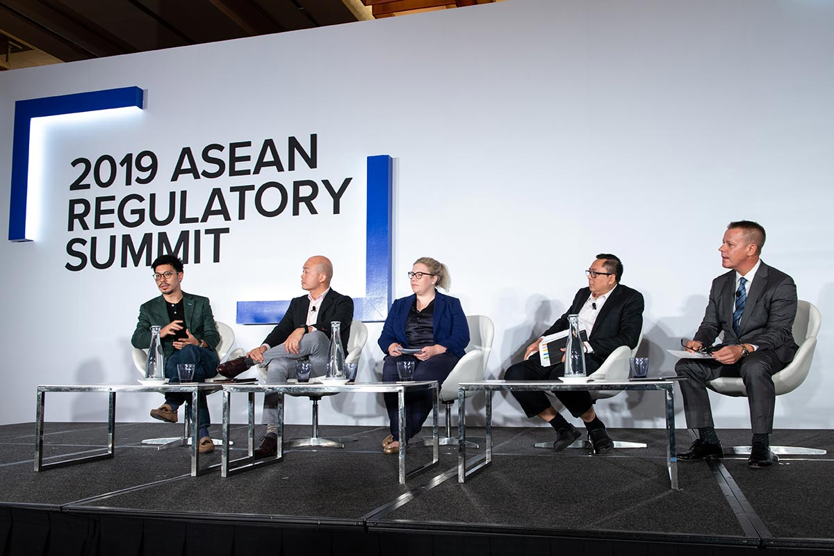 Jonathan Scott-Lee, Standard Chartered Bank; Ser-Jin Lee, Grab Financial Group; Genevieve Noakes, Transferwise; Triyono, OJK; Jeff Paine, Asia Internet Coalition. Championing fintech innovation in ASEAN