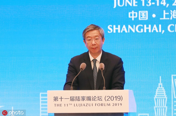 Yi Gang, governor of the People's Bank of China (PBOC), China's central bank, speaks during the 11th Lujiazui Forum 2019 in Shanghai, June 13, 2019.