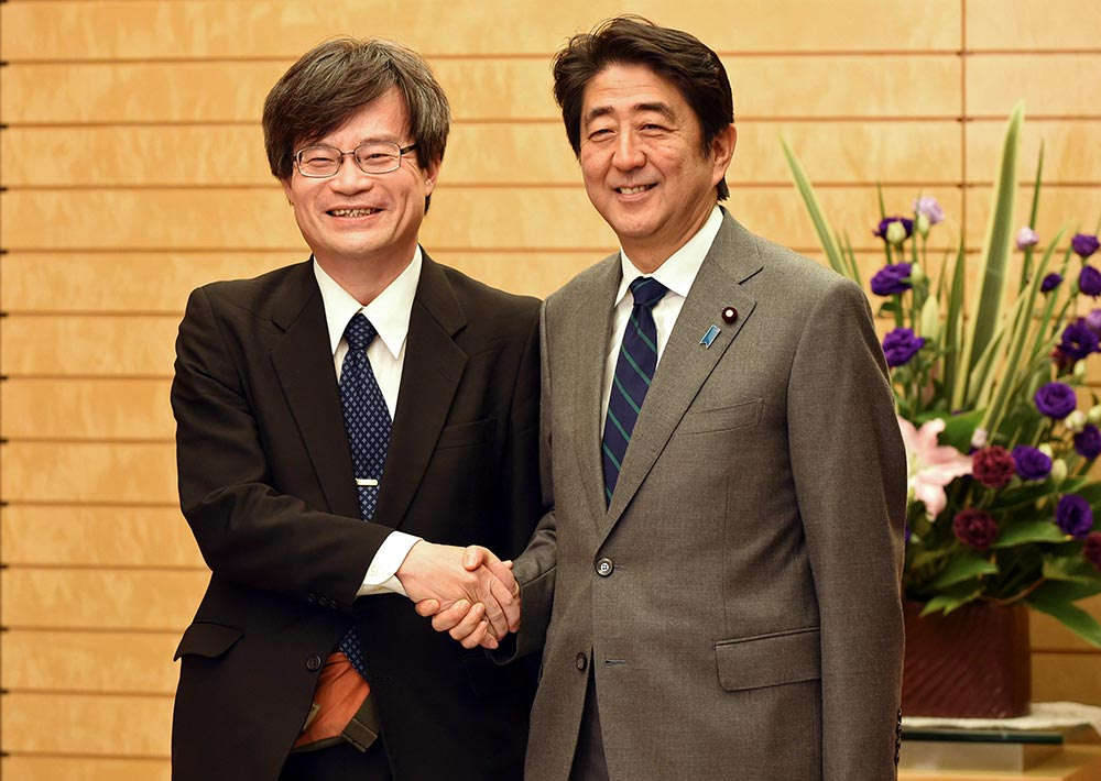 Nagoya University Professor Hiroshi Amano (L) is welcomed by Japan's Prime Minister Shinzo Abe before their talks at Abe's official residence in Tokyo. Celebrating prize-winning innovation in Japan