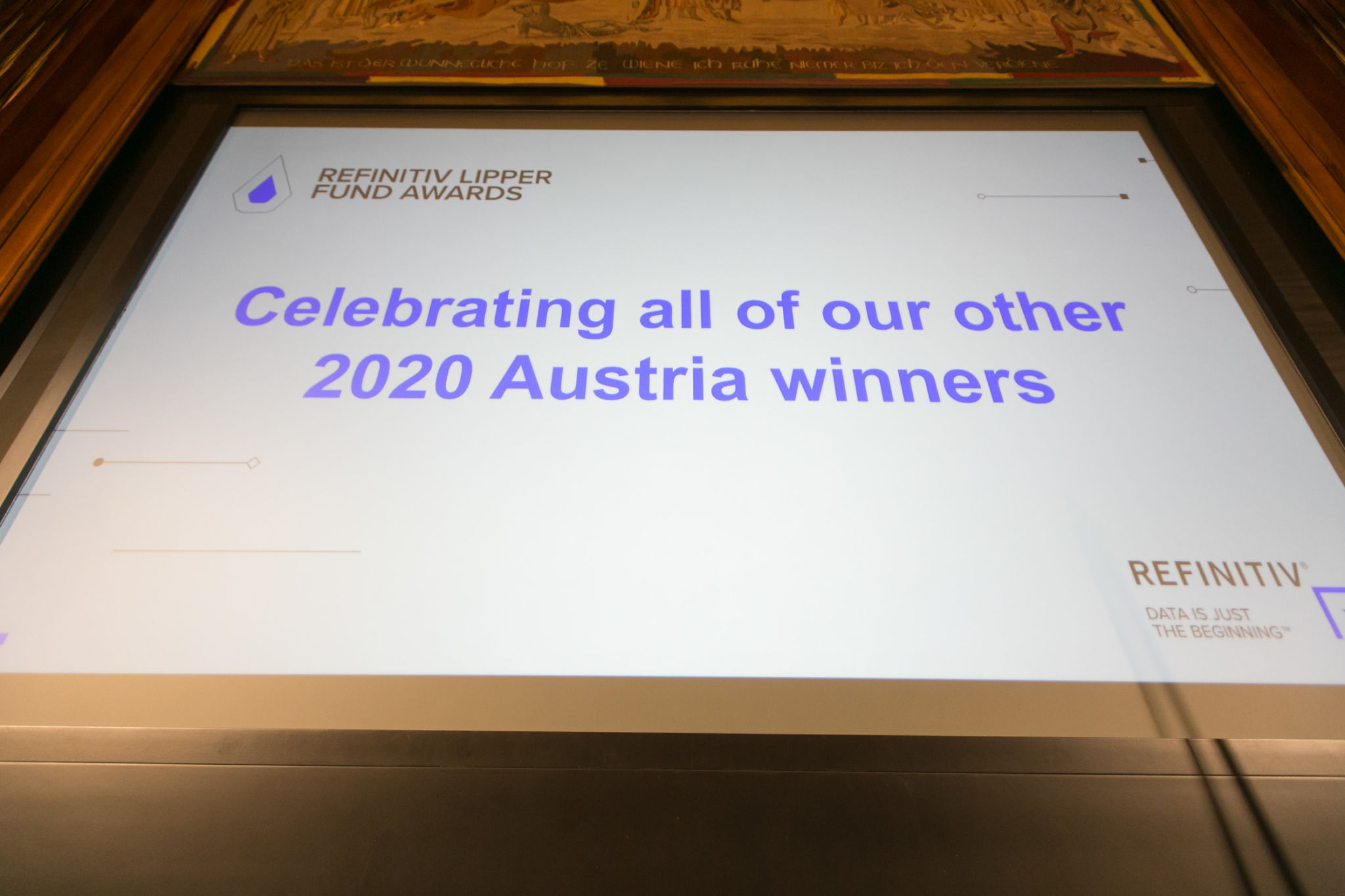 Projection of a message congratulating all of the Austria winners from Refinitiv's Lipper Fund Awards 2020