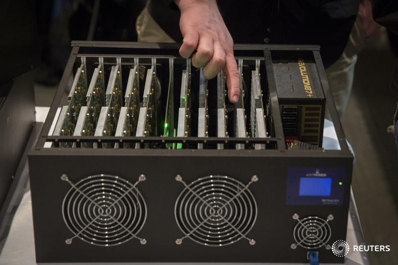 A man explains how a digital currency mining operation works while pointing at the necessary hardware during the Inside Bitcoins: The Future of Virtual Currency Conference in New York