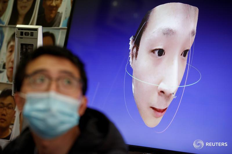 A software engineer works on a facial recognition program that identifies people when they wear a face mask at the development lab of the Chinese electronics manufacturer Hanwang (Hanvon) Technology in Beijing